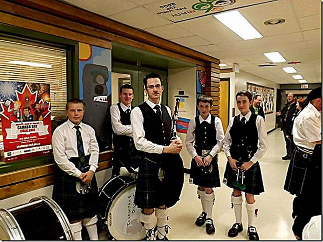 Members of the Transcona and District Pipe Band are shown.