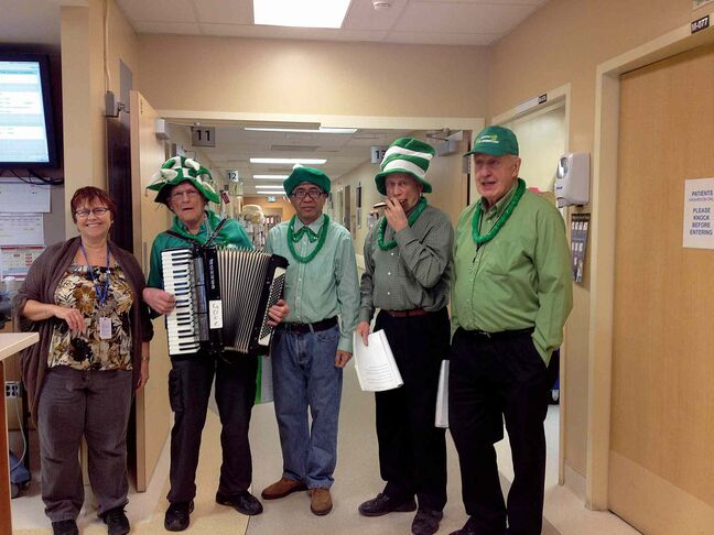 A group of local seniors from Blessed Sacrament Parish brought some St. Patrick's Day joy by playing some music for those at Concordia Hospital on March 15. John Kessling, Pedro Gregorio, Mel Belluk, and Andrew Ilchena are shown with a nurse at the hospital.