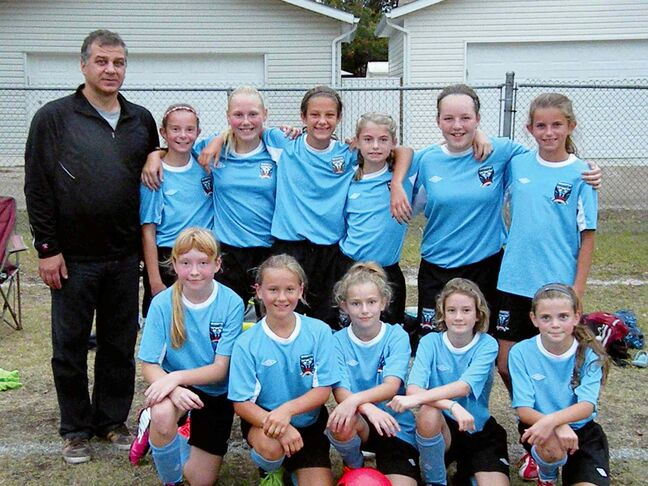 The Phoenix U11 girls' soccer team wrapped up the Cambrian City Championship with a 2-1 victory over FCNW on Sept. 28. Phoenix was strong all season, posting a 17-1-1 record in regular season play. Back row: Gian Paolucci (coach), Eryn Sitar, Amy Rheubottom, Camilla Paolucci, Cassie Friesen, Neely Hammerberg, Jenna Kunkel. Front row: Amber Szajewski, Katie Fast, Madison Zadro, Faye Wightman, Holly Johnson.
