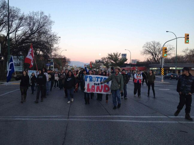 Protesters march down Portage Ave. to the RCMP headquarters Thursday evening.