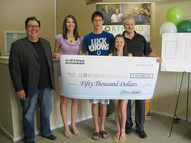 (From left) NEFC executive director Kyle Mason with Regan, Zach, Abby and Geoff Archambault. The Archambaults donated $50,000 to the community gathering place.
