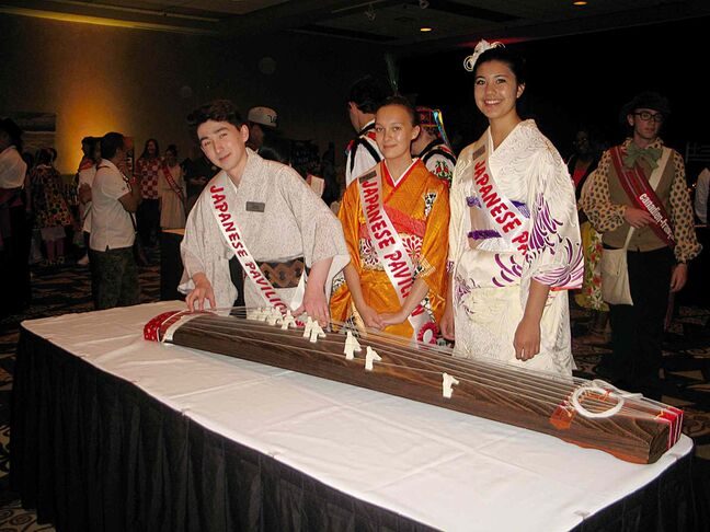 (From left) Japanese pavilion adult ambassador Russell Kunz and youth ambassadors Niina Tsuyuki Dubik and Ciara Okumura. Kunz plays the koto, a Japanese stringed instrument.