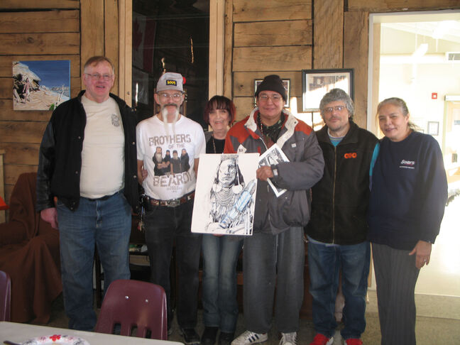 "North Point Douglas Seniors Association acting program manager Sandy Dzedzora (centre), along with volunteers (left to right) Rob Forbes, ""Duck"", Reggie Eagle Child, Ray Vilneff and Linda Hancock. Eagle Child, NPDSA's resident artist, displays his latest work in progress."