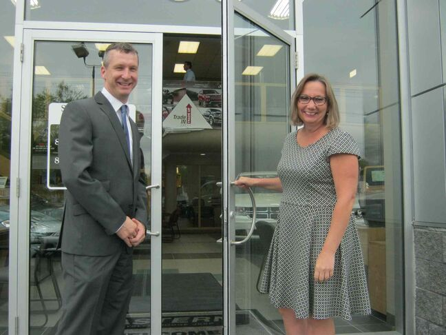 Marietta Rewucki opens the door to Eastern Chrysler for new managing partner Jim Fyles.