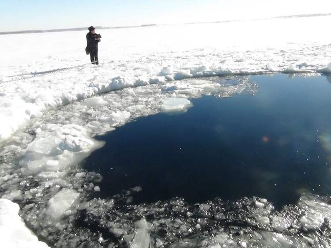 A circular hole in the ice of Chebarkul Lake where a meteor reportedly struck the lake near Chelyabinsk, about 1,500 kilometers (930 miles) east of Moscow, Russia.