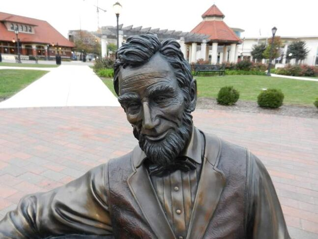 One of many statues honoring Abraham Lincoln in Springfield, Ill., is in Union Square Park. In the background is the Abraham Lincoln Presidential Library and Museum, right, and the Union Station Visitor Center, left.