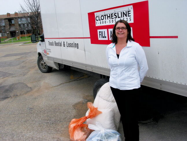 Lisa Karmazenuk, operations manager of the Clothesline program in Winnipeg, accepted donations of clothing and household items in the parking lot of Sobeys at 1500 Dakota St. on May 18 during the national Fill A Truck event. The Clothesline program raises funds to support work by the Canadian Diabetes Association.