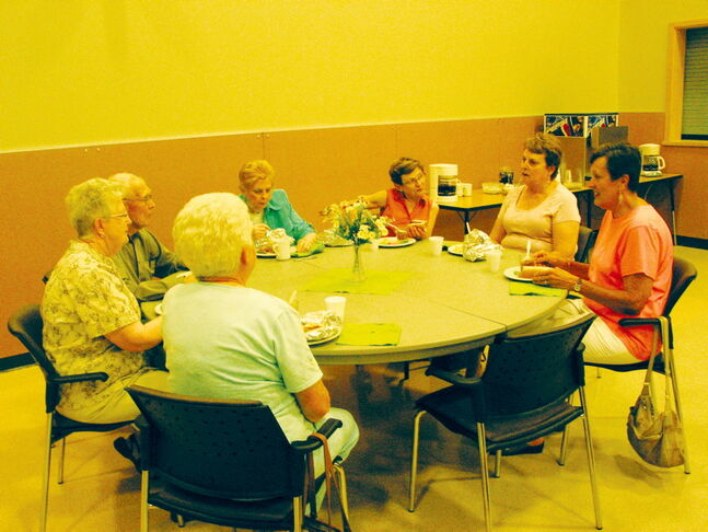Members of Headingley's 55 Plus group enjoy a barbecue lunch on June 24.