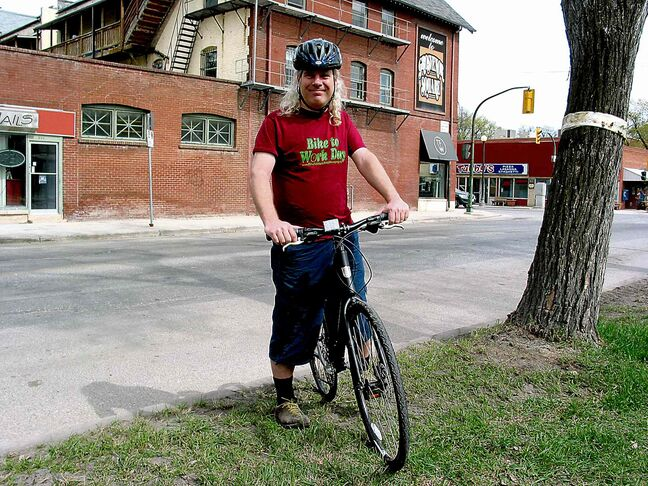 In this file photo, Mark Cohoe, executive director of Bike Winnipeg, is seen near the corner of Grosvenor Avenue and Stafford Street. The organization is encouraging individuals to attend its upcoming AGM on Nov. 16.
