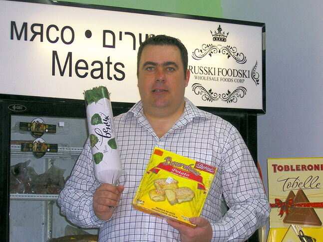 Evgeni Morduhovich, owner of Russki Foodski, with just a few samples of the products he imports from Russia, Ukraine, Israel and elsewhere.