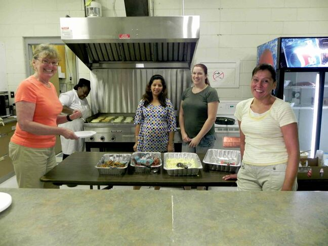 Rossmere MLA Erna Braun helps serve the pancake breakfast with Dorothy Harris-Stobbs, Shubha Bhagria, Lindsay Mack and Patricia Pohl at the Valley Gardens Community Centre's Family Fun Day on August 31.