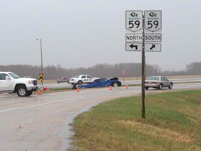 One man is dead and two people are in hospital following a collision on Highway 59 near Libau Monday afternoon.