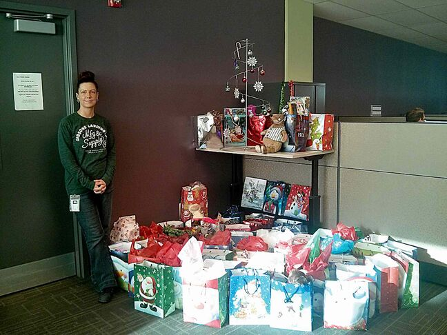 Karina Alexis with some of the gift bags that will be distributed to shelters in Winnipeg as part of the 'Christmas in a Bag' campaign.