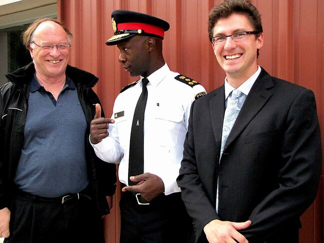 From left to right: Walter Kleinschmit, past-president of OSBRA, police Chief Devon Clunis and Matt Allard, OSBRA's current president, pictured before a community safety forum held in St. Boniface in June.