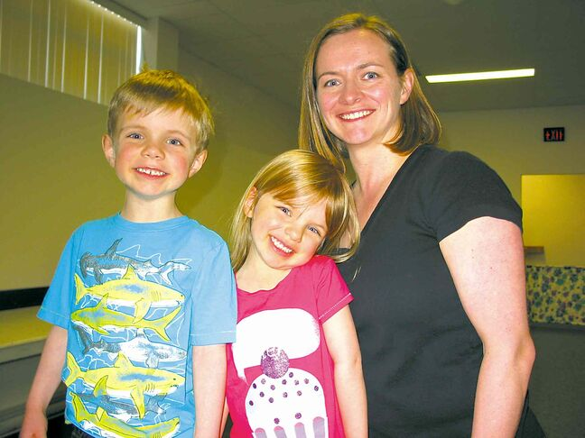 Sandra-Dee Beer, right, pictured with two of her children, Brennan, left, and Julia, centre, at a St. Vital Y Neighbours group session earlier this year.