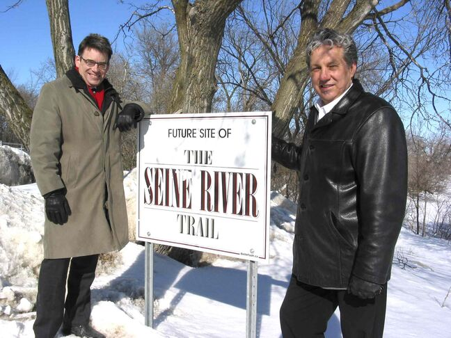 Coun. Brian Mayes (St. Vital) and Coun. Dan Vandal (St. Boniface) at the site of the future Sentier Gabriel Dufault Pathway near the Seine River Haven apartments at 571 St. Anne's Rd. in St. Vital.
