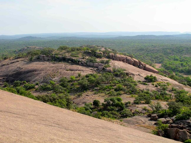 View of Hill Country from the 152-metre pink granite dome at Enchanted Rock State Natural Area in Central Texas.