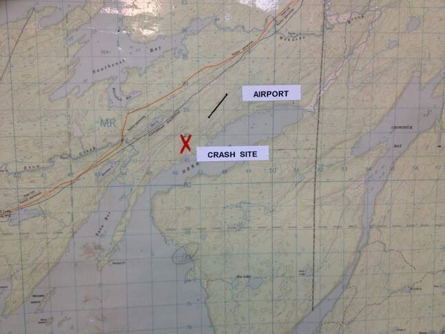 Map at Snow Lake town hall shows site of crash.