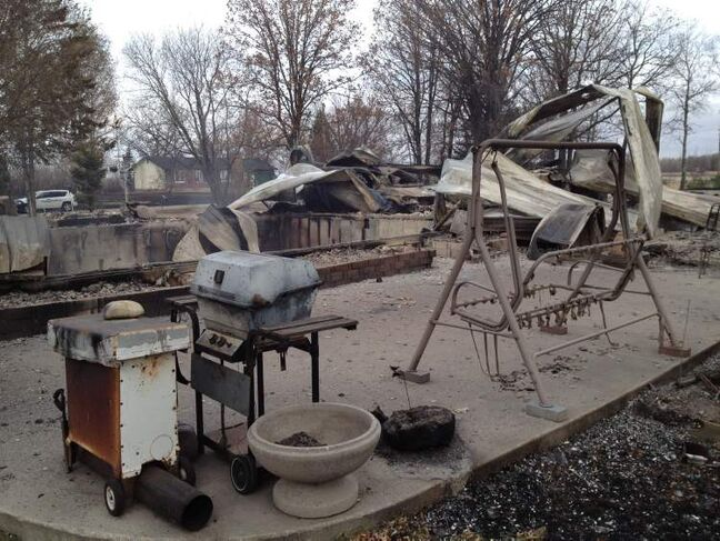 Patio furniture and a barbecue at the site of a property destroyed by fire in Vita, Oct. 3.
