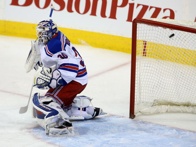 Winnipeg Jets' Andrew Ladd (16) puts the puck past New York Rangers' goaltender Henrik Lundqvist (30) during first period NHL hockey action at MTS Centre in Winnipeg, Friday, March 14, 2014.