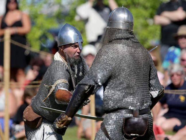 Members of Vikings Vinland battle one another during a demonstration.