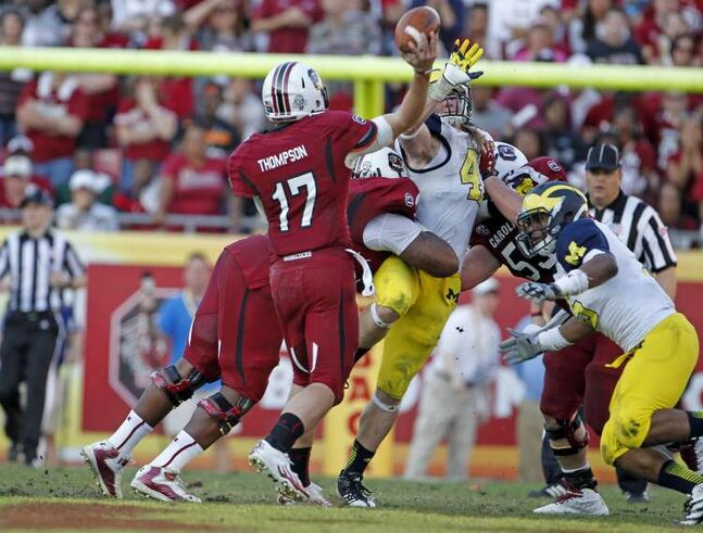 South Carolina quarterback Dylan Thompson (17) throws the game-winning 32-yard touchdown with 11 seconds to play in the fourth quarter against Michigan in the Outback Bowl at Raymond James Stadium in Tampa, Florida, on Tuesday. South Carolina rallied for a 33-28 win.