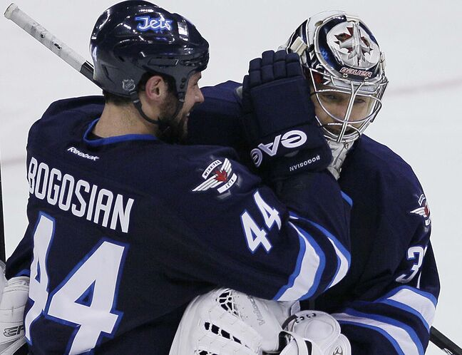 Winnipeg Jets' goaltender Ondrej Pavelec (31) and Zach Bogosian (44) celebrate their NHL win over the over San Jose Sharks in penalty shots.