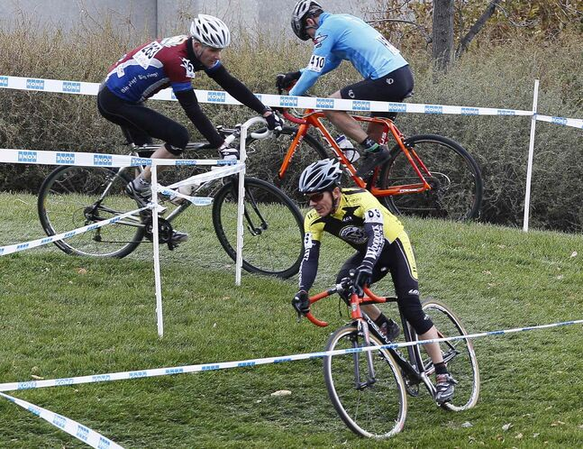 Riders make a turn at the 2013 Manitoba Cyclocross Championships.
