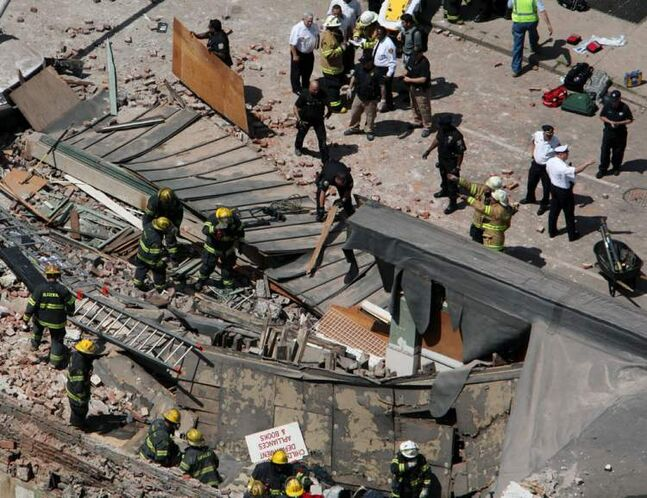 Rescuers were using buckets and their bare hands to move bricks and rubble to search for survivors.