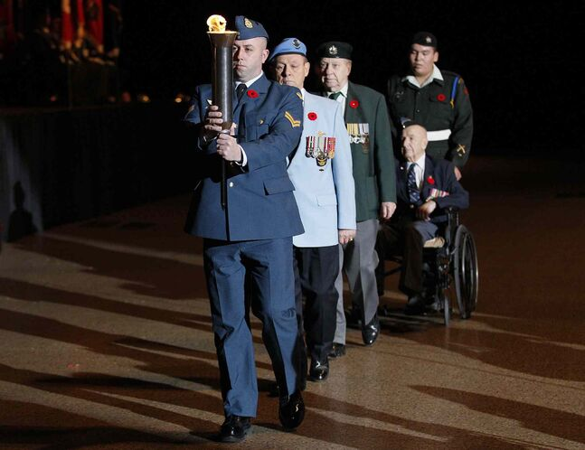 The Passing the Torch ceremony is performed during the Remembrance Day service at the RBC Convention Centre Winnipeg.