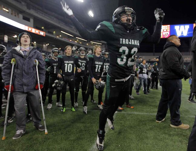 Matthew Marion (#32) of the Vincent Massey Trojans reacts as his team defeats the St. Paul Crusaders 27-19