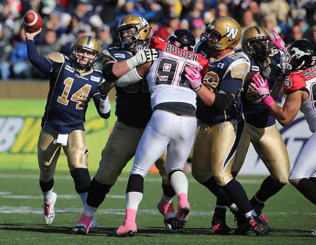 Winnipeg Blue Bombers' quarterback Joey Elliot (14) fires a pass against the Calgary Stampeders' during the second half of CFL football action at Canad Inns Stadium, Saturday, October 13, 2012.