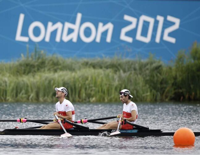 Canada's Morgan Jarvis, left, and Douglas Vandor after a lightweight men's rowing double sculls repechage in Eton Dorney, near Windsor, England, at the 2012 Summer Olympics. They arrived fourth and failed to advance to the semifinal. (AP Photo/Natacha Pisarenko)
