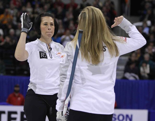 Jennifer Jones high-fives Jill Officer (left) after a shot.