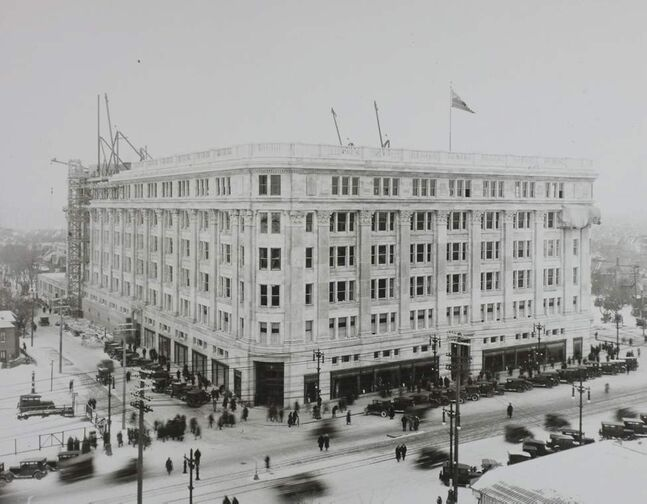 Original plans for the building's exterior called for terra cotta to be brought in from the United States. At the urging of local leaders, the Hudson's Bay Company changed its plans and agreed to use $400,000 worth of locally cut Tyndall stone. The decision not only created additional jobs in Manitoba, but allowed The Bay to later advertise that the structure was constructed with 100 per cent of Manitoba products.