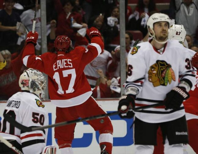 Detroit Red Wings' Patrick Eaves celebrates his first-period goal on Chicago Blackhawks goalie Corey Crawford, tying the game 1-1.