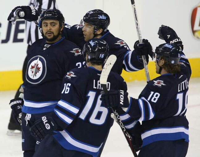 Winnipeg Jets' Dustin Byfuglien (33) opens the scoring in the first period.