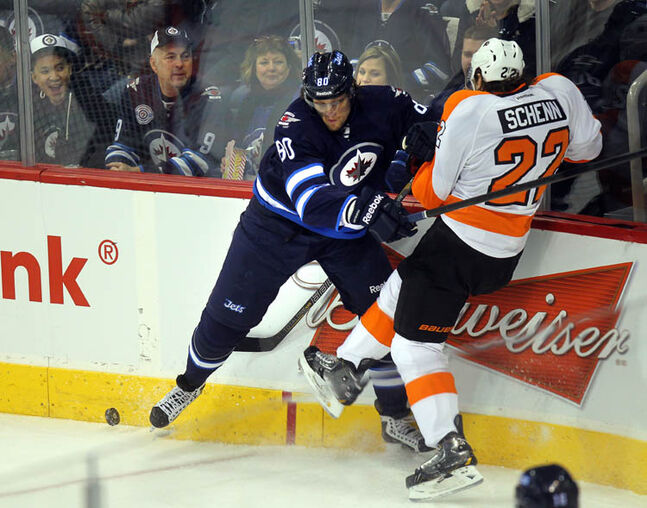 Winnipeg Jets' Nik Antropov stops Philidelphia Flyers' Luke Schenn along the boards at MTS Centre Tuesday night.