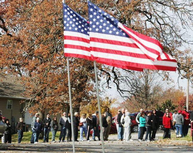 Voters wait outside Royal Heights United Methodist Church in Joplin, Mo., on Tuesday. Over the lunch hour, long lines greeted Joplin voters at polling stations.