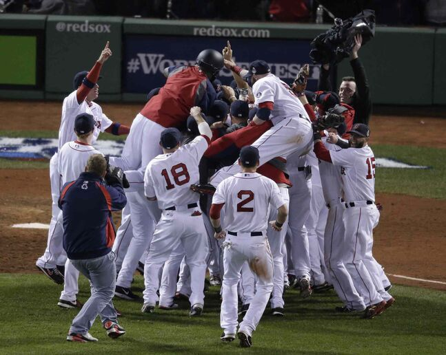 The Boston Red Sox celebrate after defeating the St. Louis Cardinals.