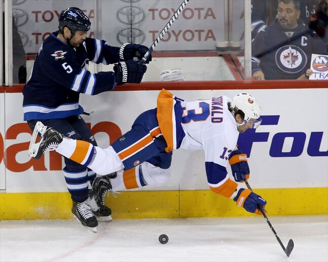 Mark Stuart levels New York Islanders' Colin McDonald.