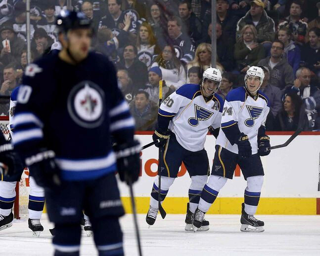 St. Louis Blues' Alexander Steen (20) celebrates with T.J. Oshie (74) after scoring in the second period.