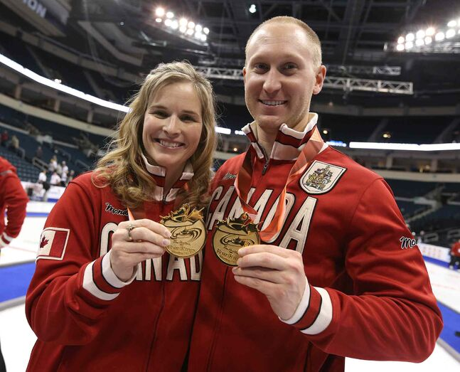 Winnipeg skips Jennifer Jones and Brad Jacobs show off their Team Canada jackets and medals.