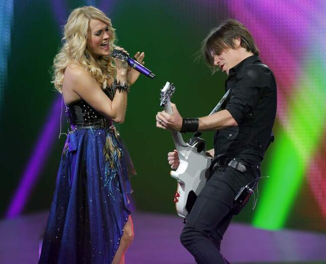 Carrie Underwood and her guitarist.