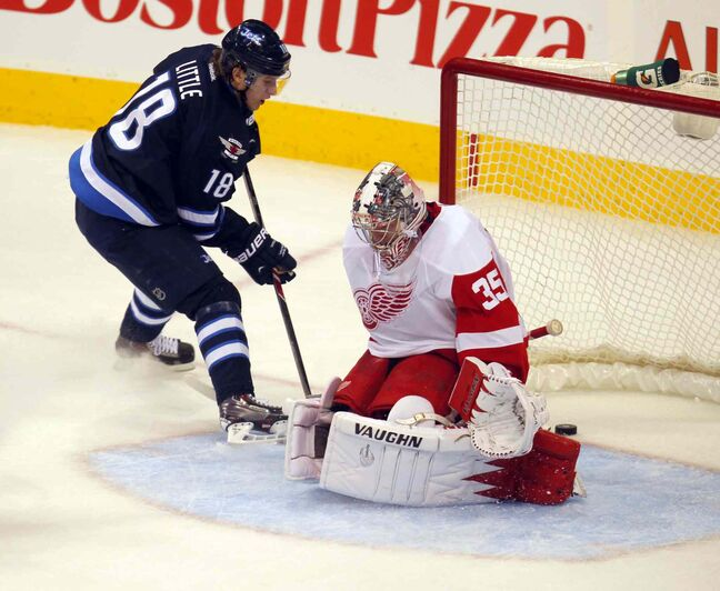 Jets forward Bryan Little scores on a breakaway against Detroit Red Wings goalie Jimmy Howard in the first period.