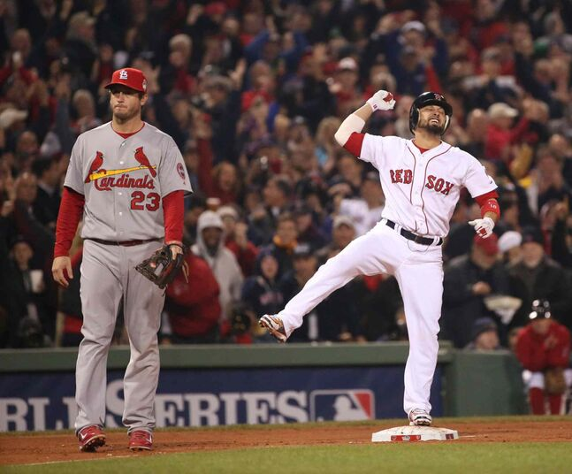 Boston Red Sox's Shane Victorino reacts after driving in three runs with a double during the third inning.