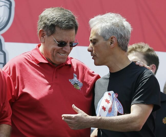 Chicago Blackhawks chairman Rocky Wirtz (left) talks with Chicago Mayor Rahm Emanuel during the rally in Grant Park.