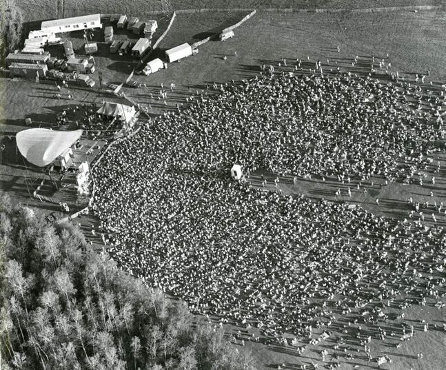 This aerial view shows some of the thousands of folk music fans who flocked to Birds Hill Provincial Park to attend the fourth annual Winnipeg Folk Festival in 1977. More than 24,000 people attended the festival. Organizers said the three-day event had become the largest folk festival in North America. (DAVE BONNER / WINNIPEG FREE PRESS)