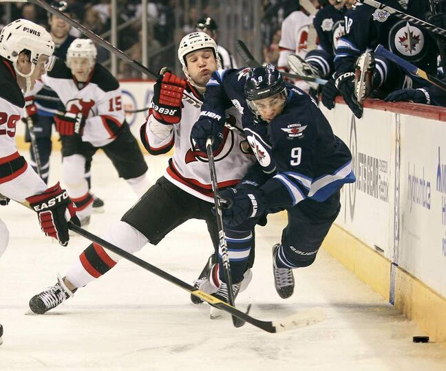 Winnipeg Jets' Evander Kane fights New Jersey Devils'  Cam Janssen for the puck during second-period action at MTS Centre Saturday. The New Jersey Devils won the game 2 - 1. January 14, 2012 (Ruth Bonneville /  Winnipeg Free Press)