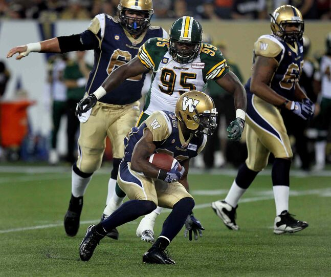Winnipeg Blue Bombers' #32 Nic Grigsby looks for room in the third quarter against the Edmonton Eskimos.